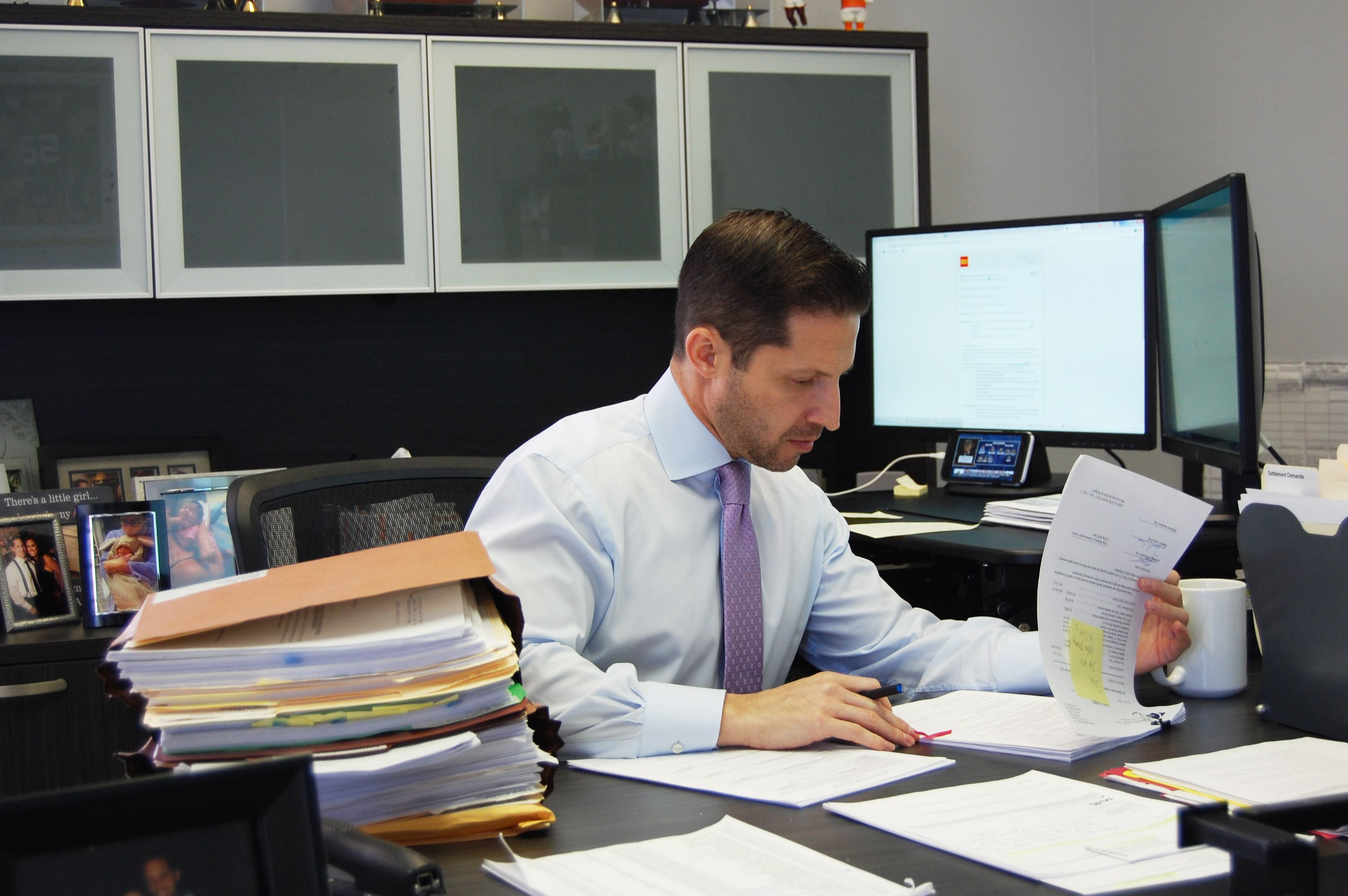 Attorney Daniel Caine Working in An Office